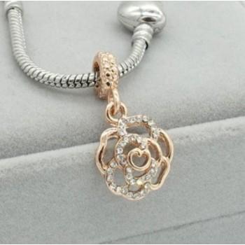 Charm rosa dorada con piedras