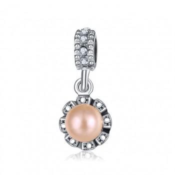 Charm con perla rosada