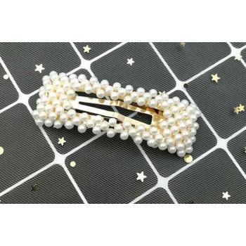 Clip grande con perlas