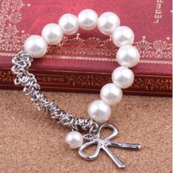 Pulsera perlas con lazo